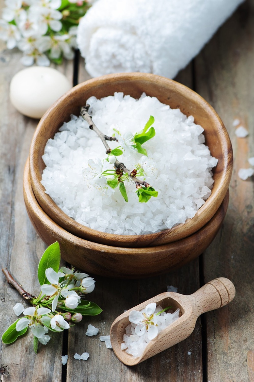 White salt and flowers for spa treatment