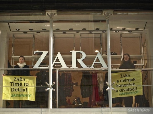"Greenpeace activists protest with banners inside a Zara store in central Budapest. Banners read 'Toxics Are Out Of Fashion!' and 'Zara Time To Detox'. Zara brand clothing products are featured in the Greenpeace report entitled ""Toxic Threads - The Big Fashion Stitch-Up"" detailing how big brands are forcing consumers to buy clothes that contain hazardous chemicals and that contribute toward toxic water pollution both when they are made, and when they are washed."