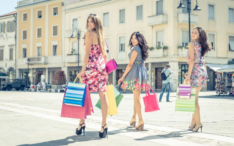 Three friends making shopping in the city center