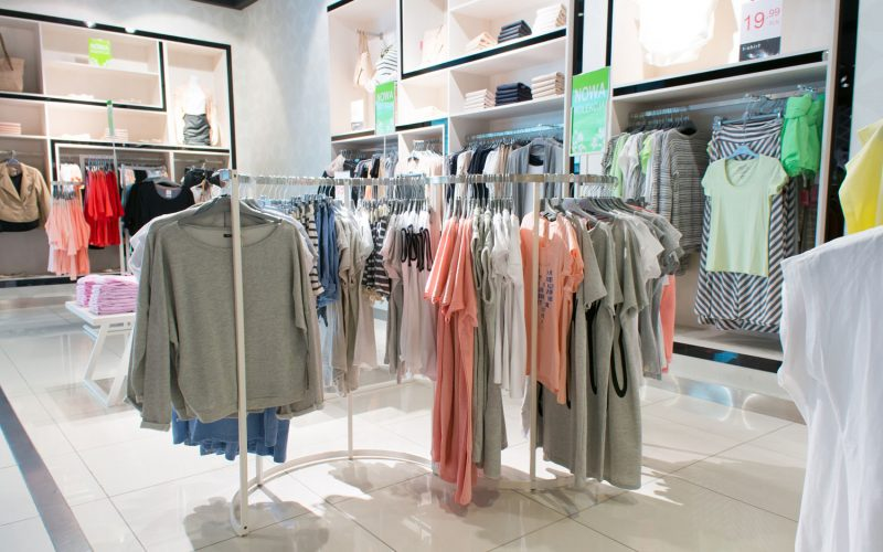 POZNAN, POLAND - MARCH 21, 2014: Hanging clothes in a Carry store at the Galeria Malta shopping mall